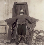 A man wearing a frame draped in material.